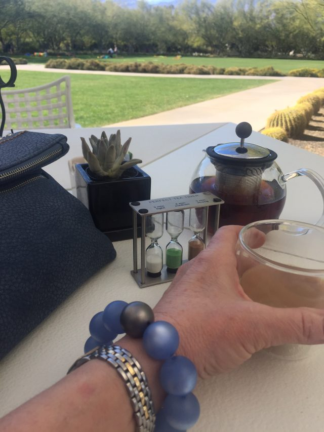 enjoying tea on the patio at the Annenberg Estate