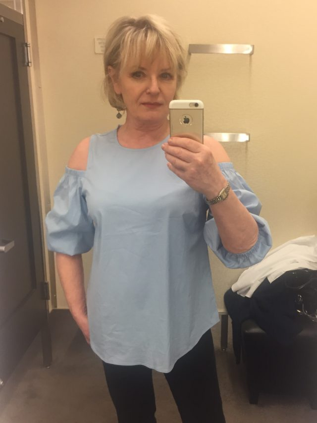 trying on cold shoulder tops at Nordstrom